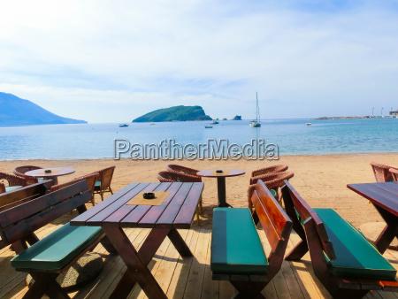 the, empty, tables, on, sea, beach - 22138483