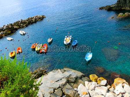 colorful fish boats on a rock