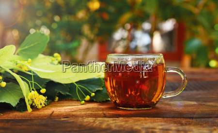 transparent mug with tea and a