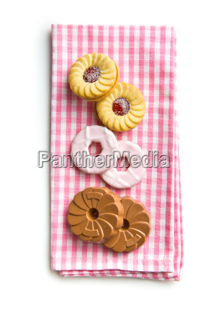 various sweet biscuits on checkered napkin
