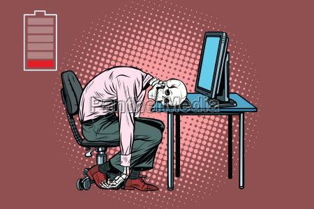 dead businessman skeleton at the computer