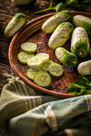 whole and sliced cucumbers