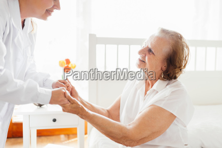 providing care for elderly doctor visiting