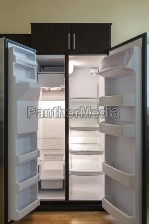 refrigerator fridge freezer empty shelves light