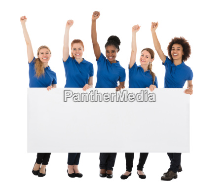 group of female janitors with billboard