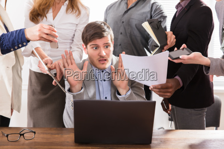 scared young businessman in office