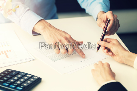 business people signing partnership contract at