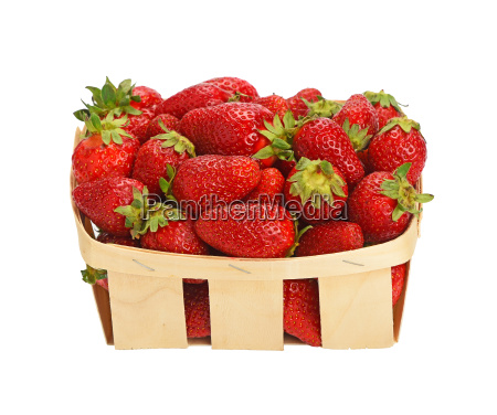 red ripe strawberries in wooden basket