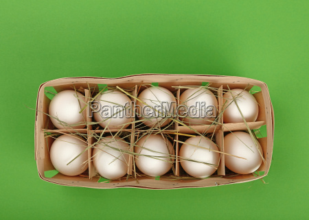 white chicken eggs in wooden container