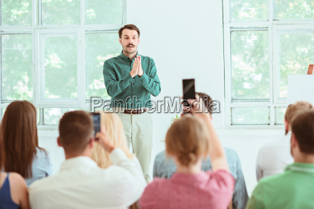 speaker at business meeting in the