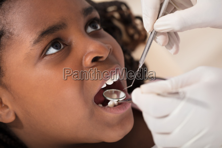 african girl at the dentist