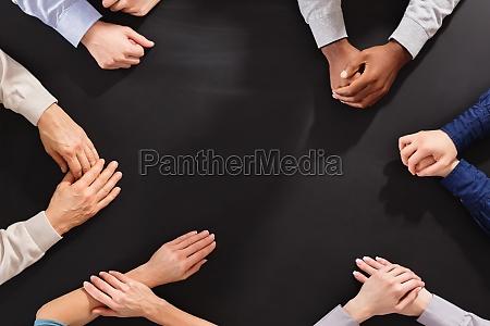 hands on black board