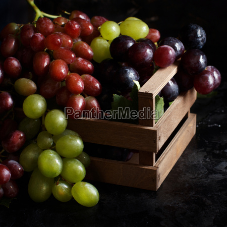 white red and blue grapes on
