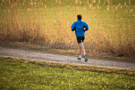 young man running outdoors on a