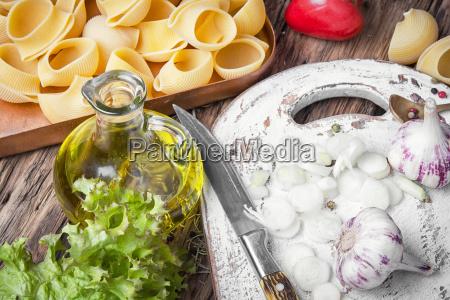 raw macaroni on wooden background