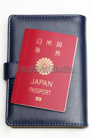 japanese passport and leather notebook isolated
