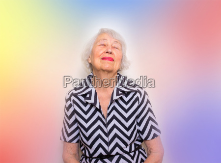 portrait of a dreaming senior woman