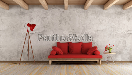 red sofa in a grunge room
