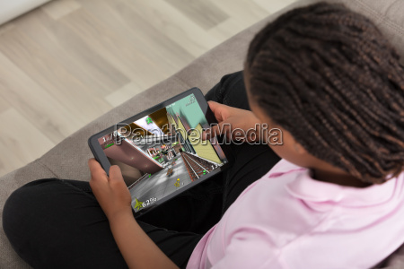 girl playing video game on digital