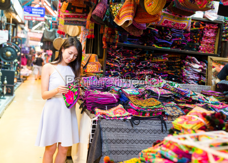 young woman shopping in weekend market