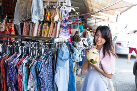 woman enjoy coconut juice and shopping