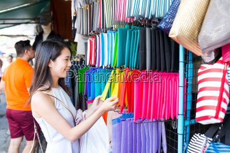 woman shopping in weekend market