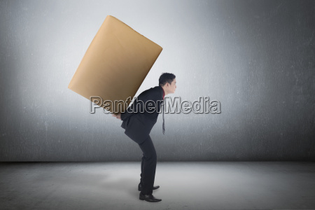 asian business man carrying brown package