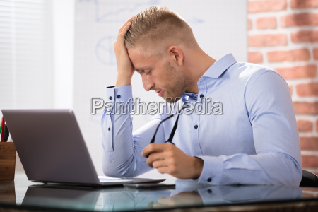 depressed businessman with laptop