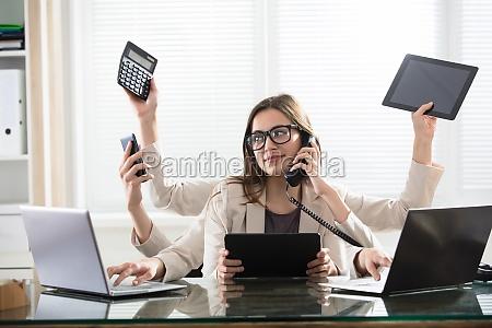 multitasking, businesswoman, in, office - 22643671