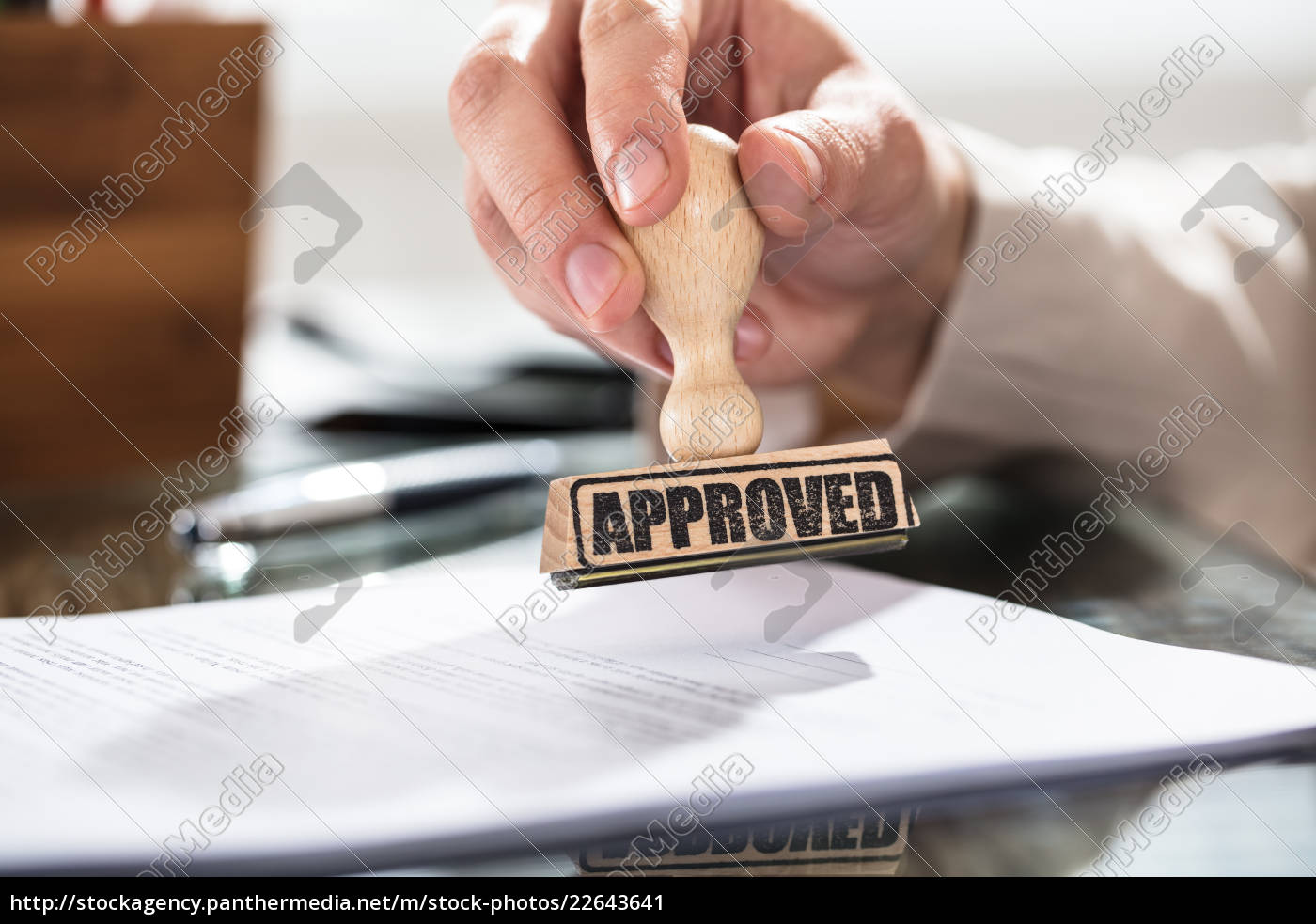 person, holding, approved, stamp, on, document - 22643641