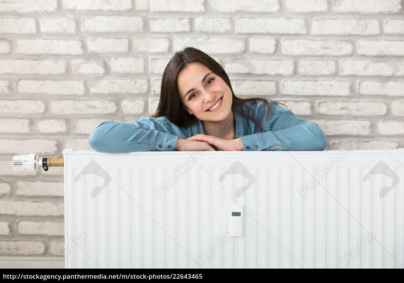 woman, behind, the, heating, radiator - 22643465