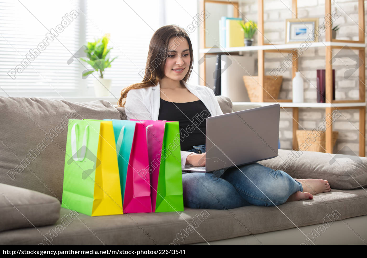 woman, using, laptop, with, colorful, shopping - 22643541