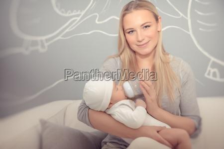 happy, mother, feeding, her, baby - 22646181