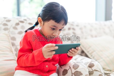 asian little girl use of mobile