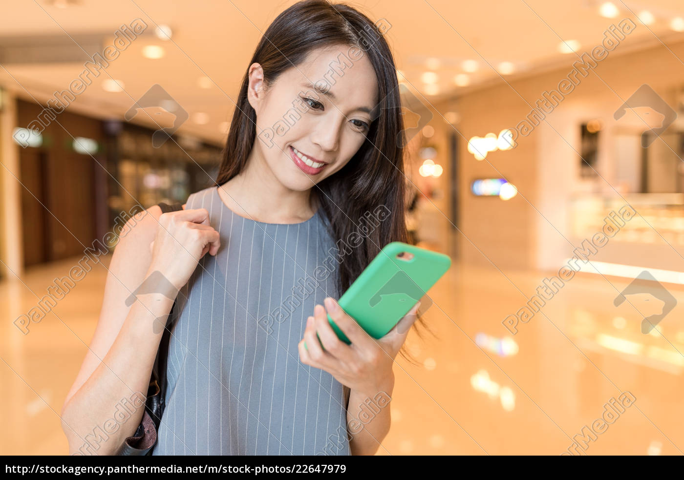 business, woman, working, on, cellphone, in - 22647979