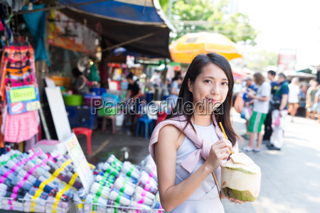 woman shopping at street and enjoy