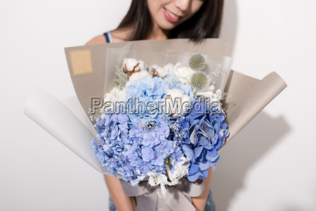 pretty woman receiving a bouquet of