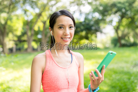 woman listen to music at park