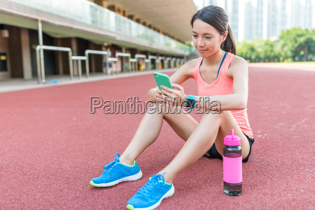 sport, woman, use, of, mobile, phone - 22648345