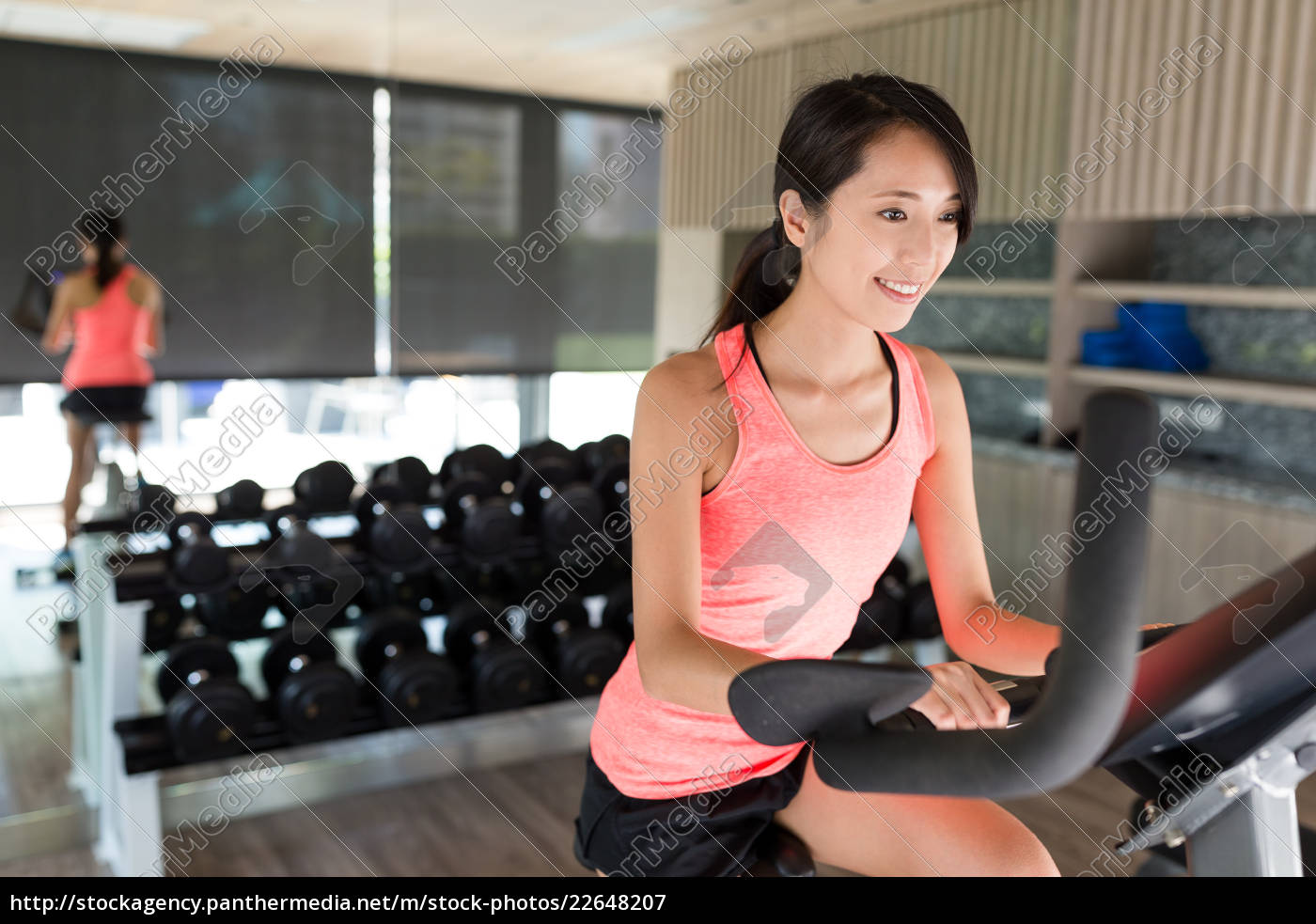 woman, cycling, in, the, gym, room - 22648207