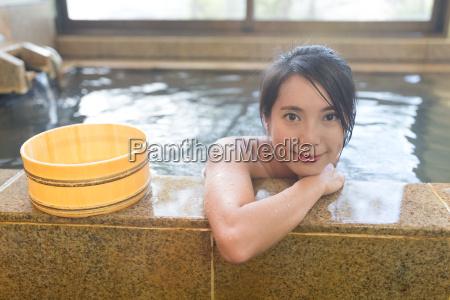 woman, having, japanese, hot, springs - 22648239