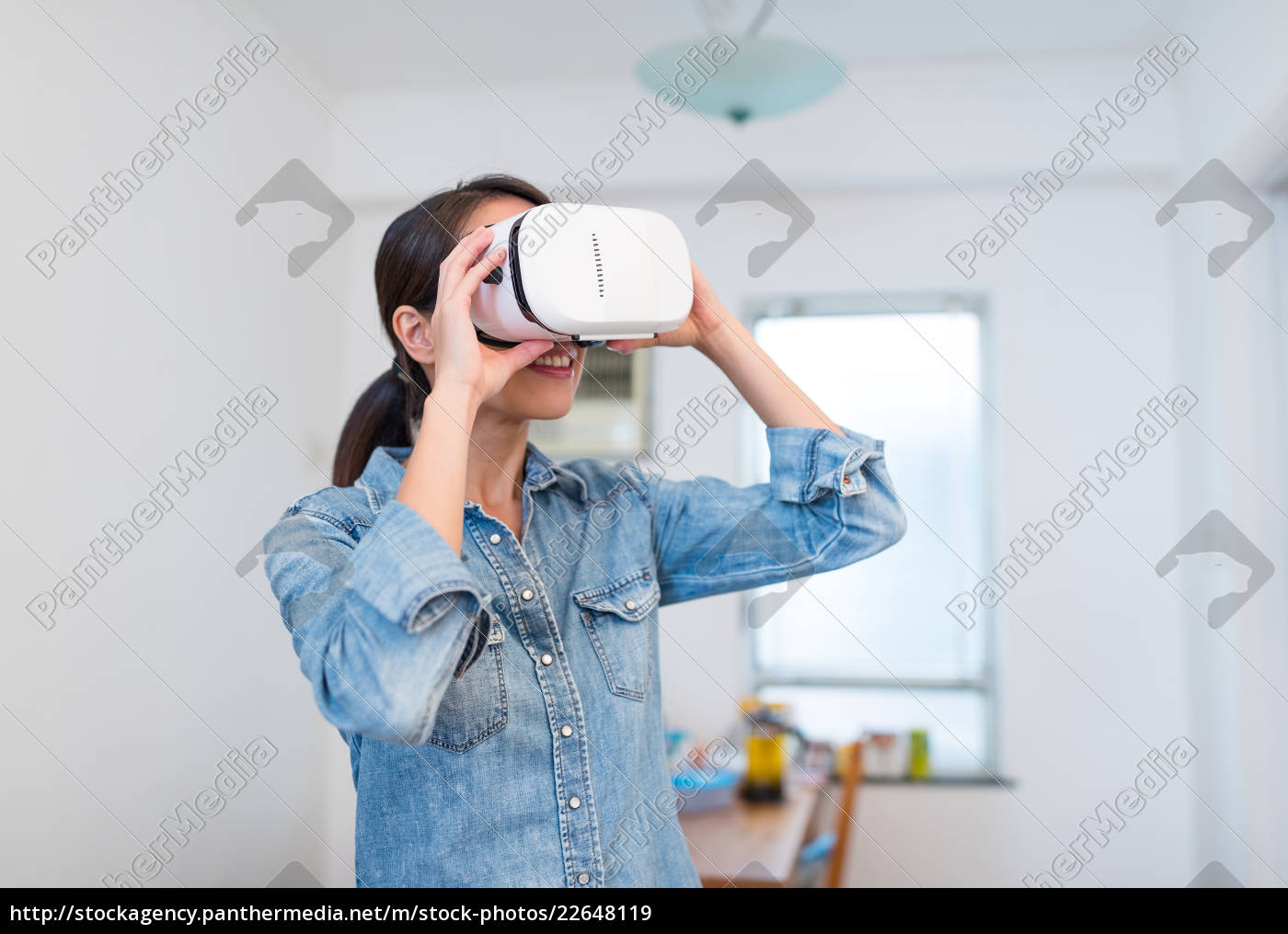 woman, looking, with, vr, device - 22648119