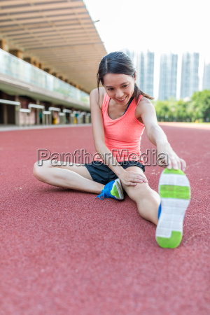 woman, stretching, legs, in, sport, court - 22648341