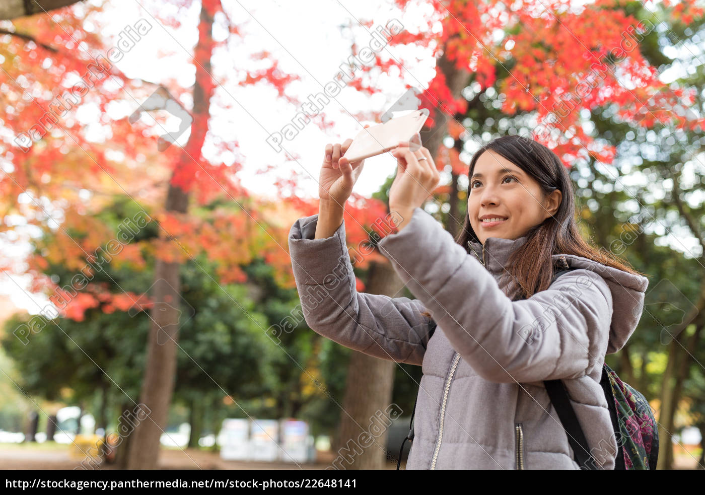 woman, taking, photo, with, cellphone, at - 22648141