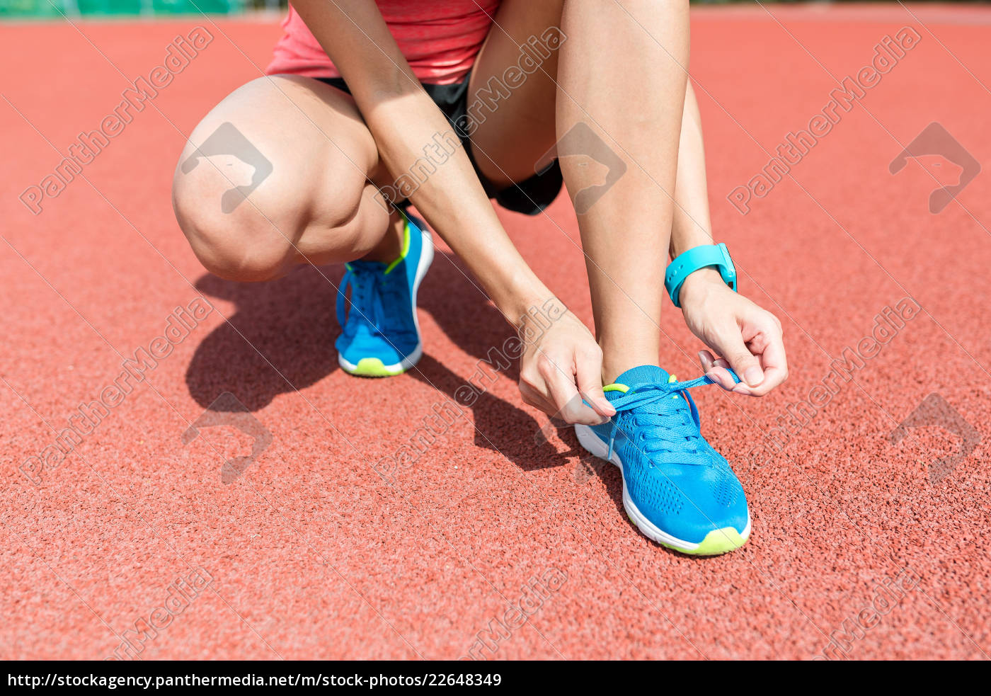 woman, tying, shoelace, on, running, shoes - 22648349