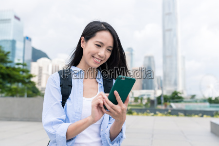 woman, using, cellphone, in, hong, kong - 22648373