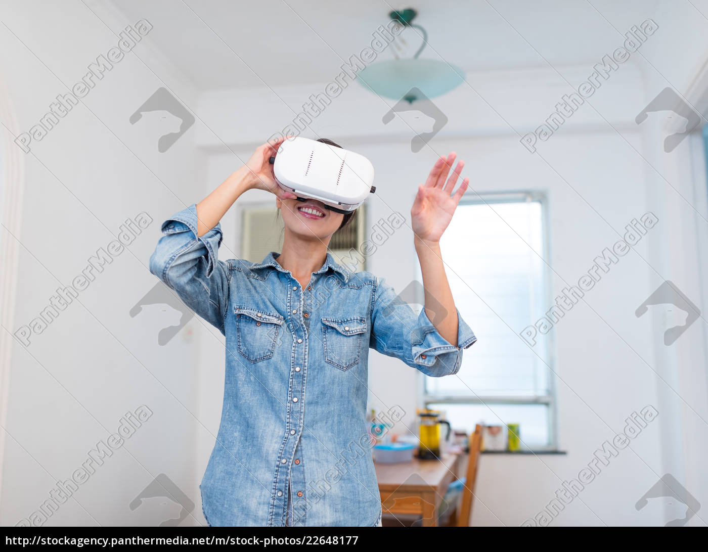 woman, watching, with, vr, device - 22648177