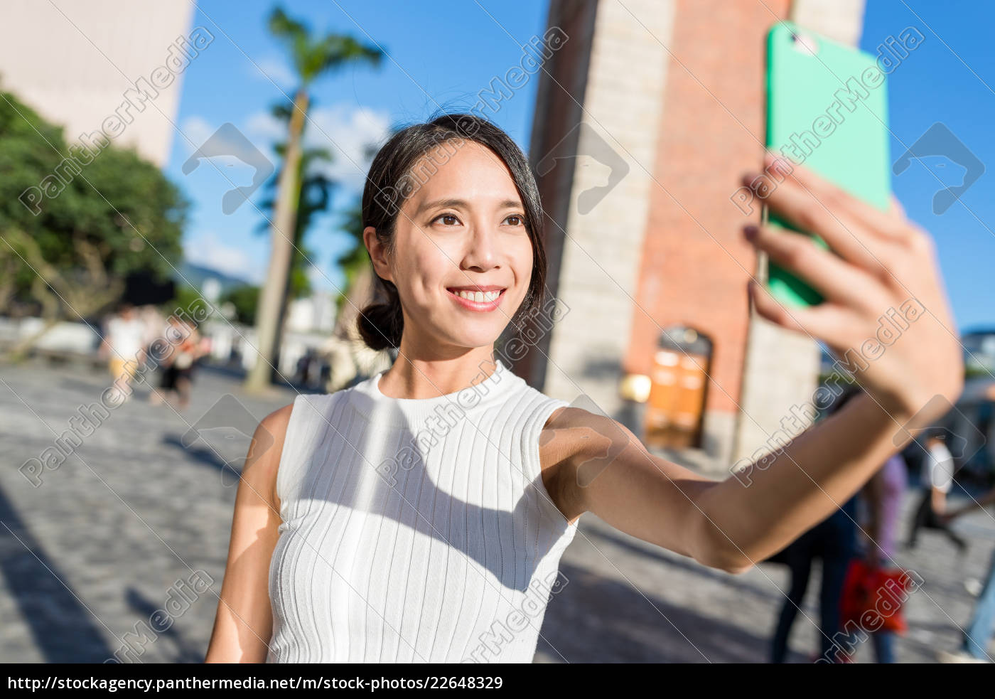 young, woman, taking, selfie, with, mobile - 22648329