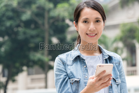 young, woman, use, of, mobile, phone - 22648133