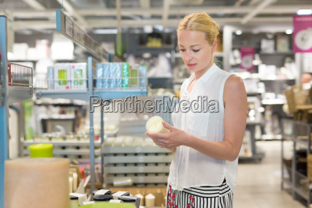 woman choosing the right item for